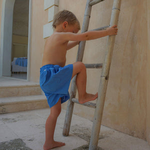 Boys swim trunks : REGATTA BLUE Childrens swimwear Mustique lifestyle