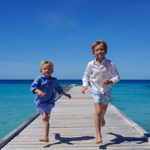 Boys swim trunks : PINEAPPLE PRICKLES - BLUE children running on pontoon Mustique