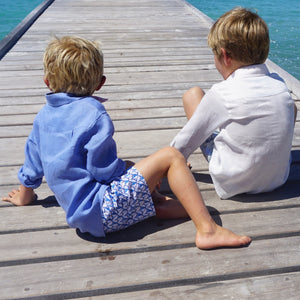 Childrens Linen Shirt: WHITE sitting on the dock Mustique