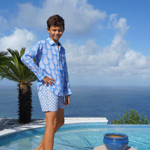 Childrens Linen Shirt: PINEAPPLE - BLUE side view by the pool Mustique
