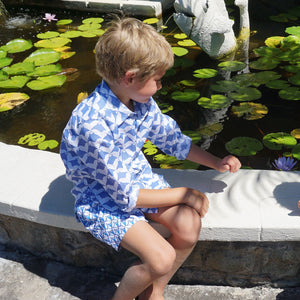 Childrens Linen Shirt: MANTA RAY NAVY sitting by the pond Mustique