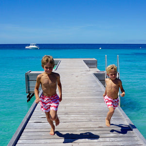 Boys swim trunks : MANTA RAY - RED running down the jetty Mustique