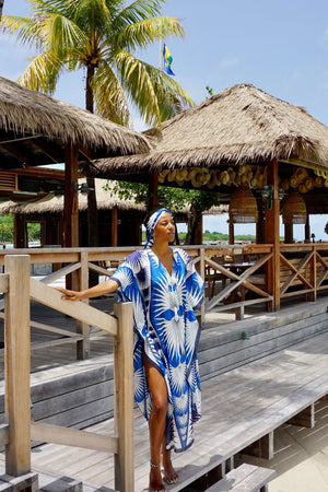 Lotty B Long Kaftan in Cotton: FAN PALM - BLUE on the veranda looking out at Basil's Mustique