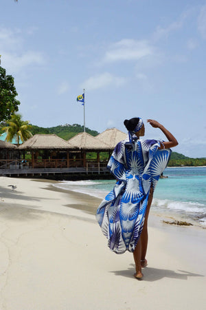 Lotty B Long Kaftan in Cotton: FAN PALM - BLUE walking on the beach to Basil's Mustique