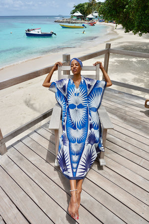 Lotty B Long Kaftan in Cotton: FAN PALM - BLUE sunbathing on the deck at Basils Mustique