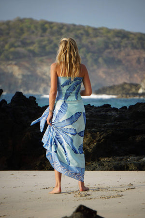 Large pure silk sarong scarf in Banana Tree blue design by Lotty B Mustique styled with matching stretch silk bandeau top