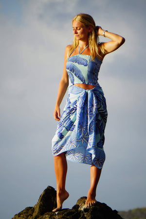 Large pure silk sarong scarf in Banana Tree blue design by Lotty B Mustique wear with matching shirred silk bandeau top