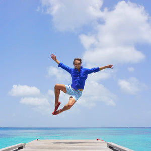 Mens swim trunks : MUSTIQUE MULE - RED on the pontoon Mustique lifestyle