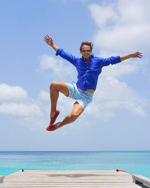 Mens designer Linen Shirt by Lotty B in plain Dazzling Blue,  jetty jump Mustique lifestyle
