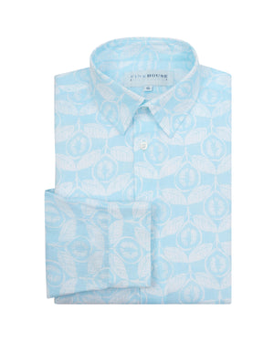 Linen shirt in Guava pale blue, designed by Lotty B Mustique Resort wear fashion