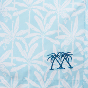 Boys swim trunks : BANANA TREE - PALE BLUE print swatch & emblem, designer Lotty B for Pink House Mustique Caribbean Kids style