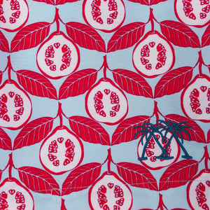 Swim shorts fabric swatch in Guava red print by Lotty B Mustique resort wear