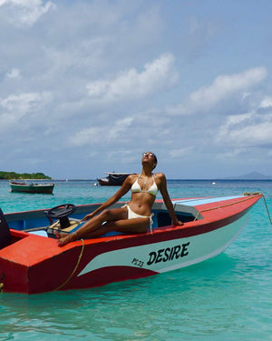 Womens Triangle Bikini : FAN PALM YELLOW on a boat named Desire Mustique