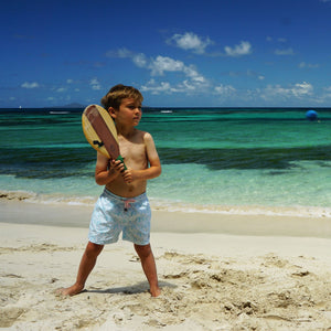 Boys swim trunks : BANANA TREE - PALE BLUE Mustique beach kids games, designer Lotty B for Pink House Mustique