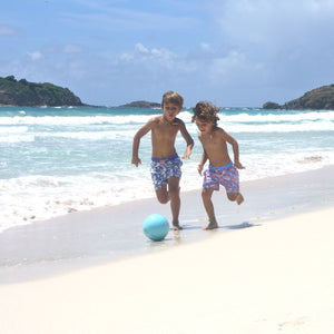 Boys Trunks (Passion Fruit Blue/Pink) playing on the beach
