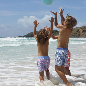 Boys Trunks (Passion Fruit Navy/Olive) playing on Lagoon beach
