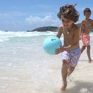 Boys Trunks (Passion Fruit Blue/Pink) running in the surf Mustique