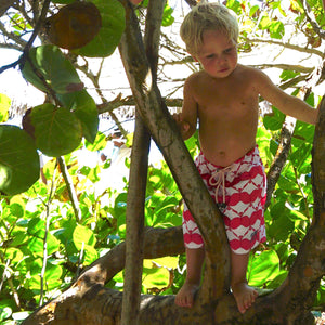 Boys swim trunks : MANTA RAY - RED jungle climbing in Mustique