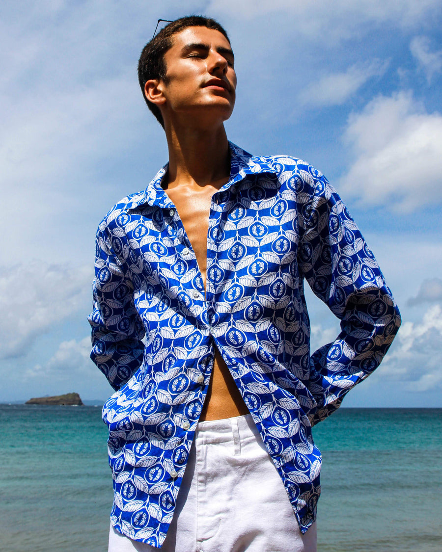 Linen shirt in Guava dazzling blue, designed by Lotty B Mustique Resort wear fashion