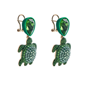 Drop earrings - Swarovski Crystal in Shining Green; green lacquer; pale gold plating; brass; pierced clip back closure; designed by Catherine Prevost for Atelier Swarovski