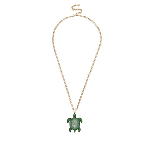 Pendant necklace - Swarovski Crystal in Shining Green; pale gold plating; brass; clasp closure; designed by Catherine Prevost for Atelier Swarovski celebrate the beauty and wonder of endangered or at risk species in the Caribbean: the Hawksbill Turtle