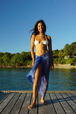 Lotty B Sarong in Silk Chiffon: FLAMBOYANT FLOWER - BLUE worn as wrap skirt with chalk white bikini. Designer Lotty B Vacation Wear Mustique style