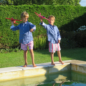 Childrens pure linen navy blue shirt & red blue guava print swim shorts  by Pink House Mustique, holiday villa lifestyle