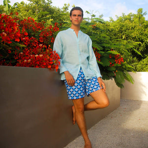 Mens designer swim trunks in Guave blue by Lotty B Mustique resort clothing