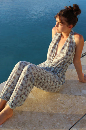 Lotty B Jumpsuit in Silk Crepe-de-Chine: BICYCLE - BLACK/PALE BLUE sitting by the pool Mustique