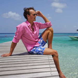 Mens designer swim trunks : MERMAID - NAVY sitting on the pontoon Mustique