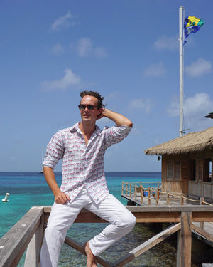 Mens Linen Shirt : MUSTIQUE MULE - RED sitting on the pontoon at Basils