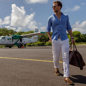 Mens Linen Trousers (White) Lifestyle at Mustique airport