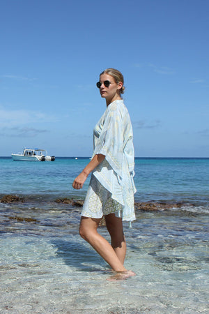 Lotty B Short Kaftan in Silk Crepe-de-Chine: PINEAPPLE - OLIVE side walking Mustique