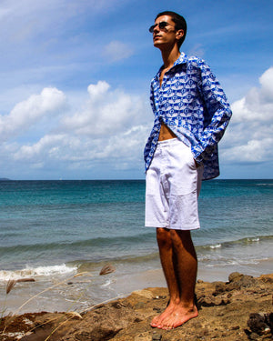 Linen shirt in Guava dazzling blue, designed by Lotty B Mustique Summer styles