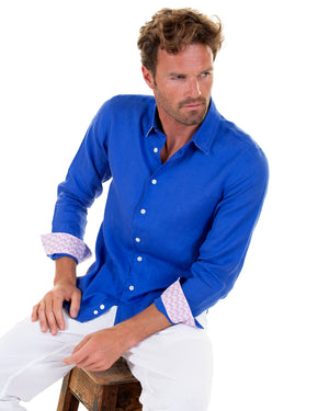 Mens designer Linen Shirt by Lotty B for Pink House Mustique in plain Dazzling Blue, Model