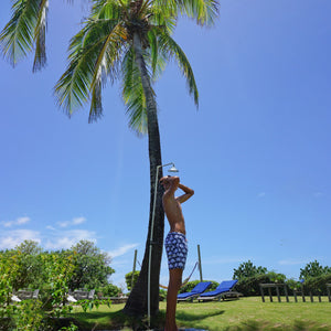 Mens swim trunks : FAN PALM - NAVY, shower under the palms Mustique
