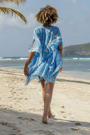 Lotty B Short Kaftan in Cotton (Shark, Blue) walk on the white sands of Mustique