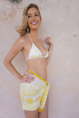 Lotty B Silk Long Silk Scarf: FAN PALM - YELLOW worn as wrap around skirt. Luxury resortwear, designer Lotty B Mustique