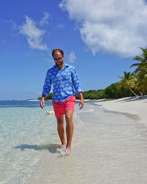 Mens Linen Shirt : FAN PALM PALE BLUE / MID BLUE, walking on Lagoon Bay Mustique