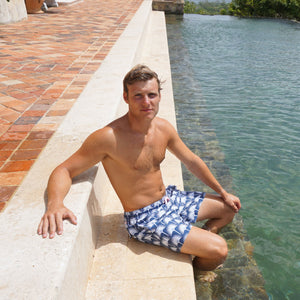 Mens swim trunks : FAN PALM - NAVY, by the pool Mustique