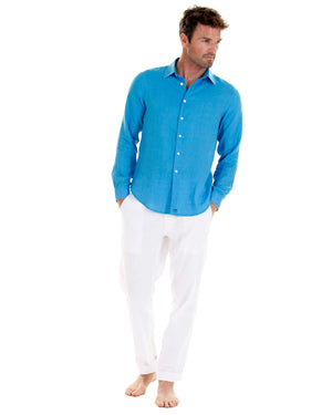 Mens designer Linen Shirt by Lotty B for Pink House Mustique in plain Turquoise Blue, model front