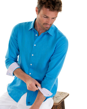 Mens designer Linen Shirt by Lotty B for Pink House Mustique in plain Turquoise Blue, model cuffs