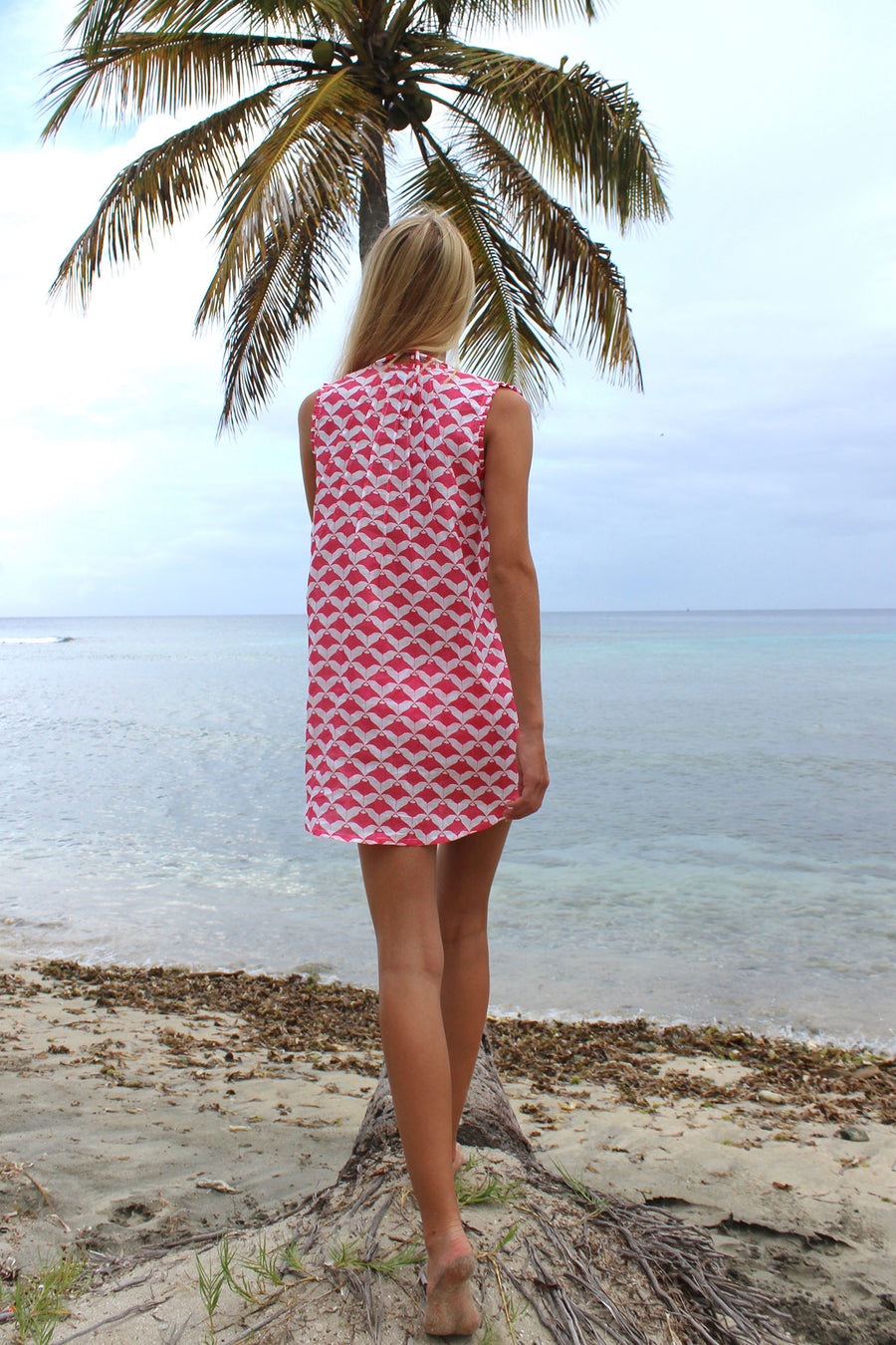 Womens Linen Beach Dress: MANTA RAY - RED sitting on palm tree Mustique