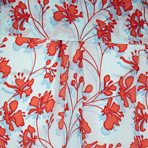 Bed to beach robe Flamboyant Flower orange aqua blue back pleat detail designer Lotty B Mustique