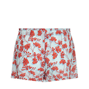 Bed to Beach shorts floral print orange on aqua blue back detail designer Lotty B Mustique