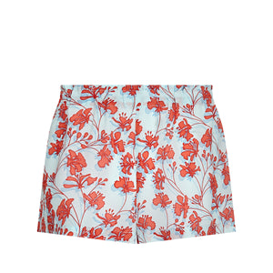 Bed to Beach shorts floral print orange on aqua blue designer Lotty B Mustique