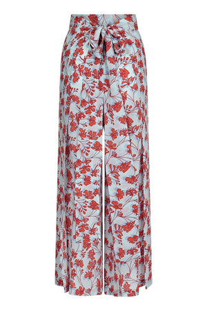Silk Gabija Palazzo Pants ties at the back: FLAMBOYANT FLOWER - ORANGE wide leg trousers designed by Lotty B Mustique