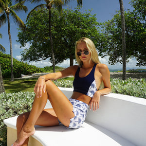 Sports Shorts worn with matching cropped top : FAN PALM NAVY designed by Lotty B for Pink House Mustique
