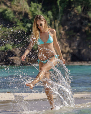 Womens Triangle Bikini: TURQUOISE splashing on the beach Mustique