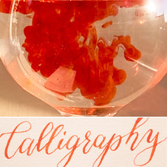 vermilion orange calligraphy and ink in water
